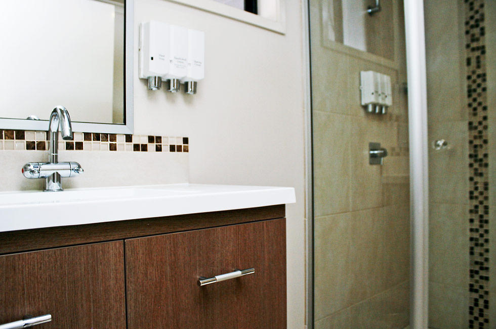 All bathrooms at Johnson Road Motel in Hillcrest have showers, vanities and large mirrors